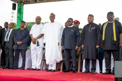 President Muhammadu Buhari is joined by R-L: Governor of Imo State Rochas Okorocha, Governor of Akwa Ibom state Emmanuel Udoma, Governor of Calabar Prof. Ben Ayade, An APC Chieftain Chief Obono Obla during the Ground Breaking Ceremony of 260Km Super Highway Double Carrier Road from Calabar to Northern Nigeria on 20th Oct 2015.