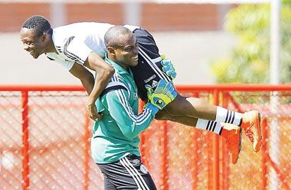 Enyeama lifts Ahmed Musa on his shoulder at a training session prior to 2014 W/Cup in Brazil.