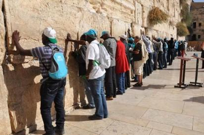 Pilgrims: Nigerian Christian Pilgrims and others from Other countries praying at  Western Wall ( Wailing Wall) in Jerusalem, Israel .