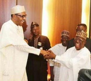 President Muhammadu Buhari in handshake with Governor Idris Wada