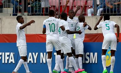OCTOBER 17: Team members of Nigeria celebrate their opening goal during the FIFA U-17 Men's World Cup 2015 group A match between Nigeria and USA at Estadio Nacional de Chile on October 17, 2015 in Santiago, Chile. FIFA