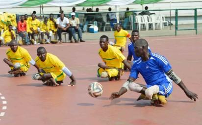 WALE, AN OSUN PARA-SOCCER STRIKER, BREAKING THROUGH THE OPPONENTS'DEFENCE DURING THE OPENING  MATCH BETWEEN OSUN AND KWARA AT THE ONGOING 3RD WORLD POLIO DAY NATIONAL PARA-SOCCER TOURNAMENT IN ABUJA. OSUN WON 3-0.