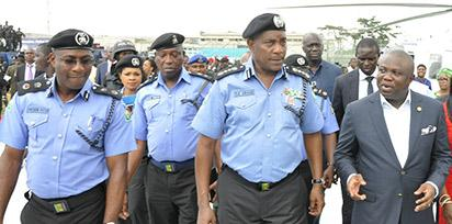 Governor Akinwunmi Ambode; Inspector General of Police, Mr. Solomon Arase and Commissioner of Police, Mr. Fatai Owoseni, during the commissioning and handing over of Patrol Vehicles, Motorcycles, Armoured Personnel Carriers (APCs), Gunboats, Patrol Helicopters to the Nigerian Police and the Rapid Response Squad (RRS), at the Lagos House, Ikeja, on Friday, November 27, 2015.