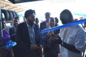 •Managing Director of Infinity Tyres Group, Mr. Arshi Chadha (Right) cutting the tape to commission Infinity Express Ghana.