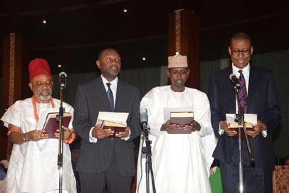 L-R; New Ministers Sen.Chris Ngige (Labour and Employment); Sen. Udoma Udo Udoma (Budget and Planning); Alh.Mohammed Musa Bello (FCT); and Mr. Okechukwu Eyinna Enelamah (Industries, Trade and Investments) taking the oath of Office as Federal Ministers before President Muhammadu Buhari during their swear-in ceremony, held at the Presidential Villa Abuja. Photo by Abayomi Adeshida 11/11/2015