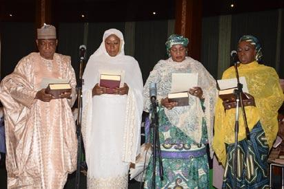 L-R; New Ministers Brig. Gen. Munsur Mohammed Dan Ali (Defence); Hajia Khadija Bukar Ibrahim ((State Foreign Affairs); Aisha Jummai Alhassan (Women Affairs); and Hajia Aisha Abubakar (State, Trade and Investments) taking the oath of Office as Federal Ministers during their swear-in ceremony, held at the Presidential Villa Abuja. Photo by Abayomi Adeshida 11/11/2015