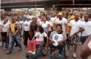 """Hon. Desmond Elliot with some of the physically challenged in Surulere during the """"Surulere Women Walk."""""""