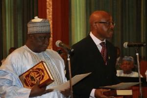 Mr. Mustapha Leki and ALHAJI Baba Shettima (l) taking the oath of office during the swear-in ceremony of the INEC Chairman and five National Commissioners at the Aso Chambers, State House, Abuja. Photo by Abayomi Adeshida 09/11/2015