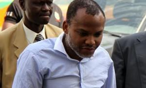 Director of Radio Biafra, Nnamdi Kanu, sandwiched between security operaives, leaving the court yesterday in Abuja.
