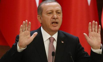 "Turkish President Recep Tayyip Erdogan delivers a speech during a mukhtars meeting at the presidential palace on November 26, 2015 in Ankara. President Recep Tayyip Erdogan on November 26 said Turkey does not buy any oil from Islamic State, insisting that his country's fight against the jihadist group is ""undisputed"". AFP PHOTO"