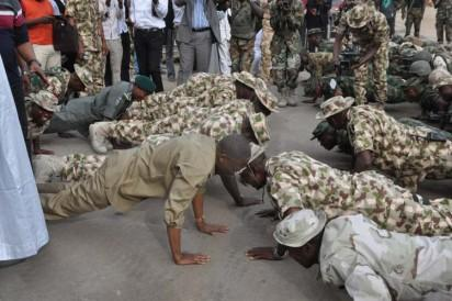 Bama IDP Camp:  From left, Minister of Information and Culture, Alh. Lai Mohammed joining Military in 21 Press-up with Theater Commandant, Maj. Gen. Abubaskar , Major Gen. Adeosun  Brigadier Commander, 21 Brigade Bama and others   during Minister's Tour of Bama . Photo by Gbemiga Olamikan.