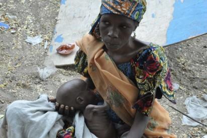 Bama IDP Camp:  A Mother , Yakana  from Kanuri with her baby at Bama IDP Camp in Maiduguri  during Minister's Tour of Bama . Photo by Gbemiga Olamikan.