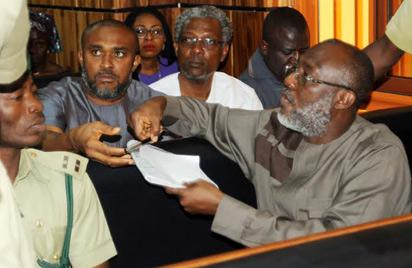 METUH IN COURT—Publicity Secretary of the Peoples Democratic Party, Pdp, Chief Olisa Metuh, signing a document at the Federal High Court, Abuja, yesterday. Photo: NAN.