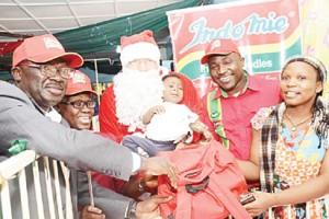 DONATION: From Left: Medical Director  and Apex Nurse ,  Gbagada  General Hospital, Dr Lateef  Tayo Lawal and Mrs. Oluwabuyide Abosede respectively; Santa Claus, with a patient ,Chidima Uchnna; PRO & Event Manager, Dufil Prima Foods Plc. Mr. Tope  Ashiwaju, and Mrs Edith Uchnna during the Indomie Santa Surprise visit to  Gbagada General Hospital, Lagos recently.