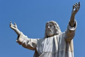 """A picture taken on January 1, 2016 shows the nine-metre tall statue of Jesus Christ carved from white marble, thought to be the biggest of its kind in Africa, unveiled in Abajah, southeastern Nigeria. Standing barefoot with arms outstretched, the """"Jesus de Greatest"""" statue weighs in at 40 tonnes. More than 100 priests and hundreds of Catholic worshippers attended the nine-metre (30-foot) statue's official unveiling in the village of Abajah in southeastern Nigeria. It was commissioned by Obinna Onuoha, a local businessman who hired a Chinese company to carve it and placed it in the grounds of a 2000-capacity church that he built in 2012. / AFP"""