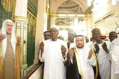 President Buhari at Prophet Muhammad's Mosque in Medina to commence the lesser Hajj, Umrah. With him is the NSA, Maj-Gen, Babagana Monguno (retd)