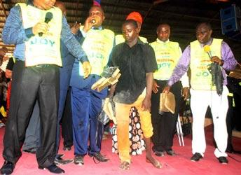 Mallam Hassan Abba surrounded by Chosen's verifiers at the crusade