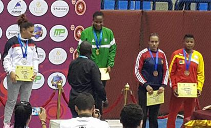 GOLDEN SMILE . . . Blessing Oborodudu ( c ) receiving her certificate from an official after winning the gold medal in 69kg weight class at the 2016 Senior African Wrestling Championships, in Alexandria,Egypt.