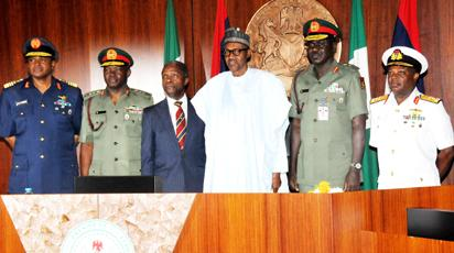 PIC.1. FROM LEFT: CHIEF OF THE AIR STAFF, AIR-MARSHAL SADIQUE ABUBARKAR;   CHIEF OF DEFENCE  STAFF,  GEN. ABAYOMI GABRIEL OLONISAKIN;  VICE  PRESIDENT YEMI OSINBAJO; PRESIDENT MUHAMMADU BUHARI; CHIEF OF ARMY STAFF,  LT-GEN. TUKUR  BURATAI AND  CHIEF OF NAVAL  STAFF, VICE-ADMIRAL IBOK ETE  EKWE  IBAS, AT THE DECORATION OF SERVICE CHIEFS AT THE PRESIDENTIAL VILLA IN ABUJA ON THURSDAY (13/8/15). 5926/13/8/2015/ICE/CH/NAN