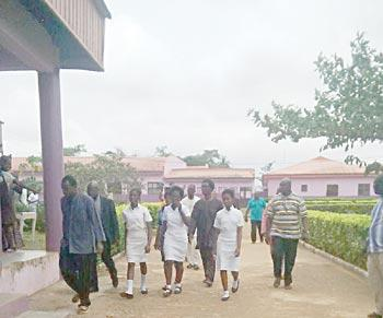 File: Babington schoolgirls returning to school after their abduction