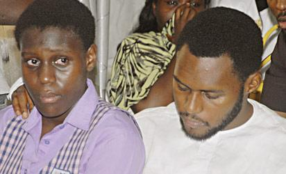 CONDOLENCE—Daughter of late James Ocholi, Ale and son, Aaron Ocholi at the residence of the late Minister of State at Kado Estate, Abuja, yesterday. Top Right: Minister of Labour and Employment, Dr. Chris Ngige signing the condolence register for Late Ocholi. Below right: Sympathisers at the residence. Photos: Abayomi Adeshida