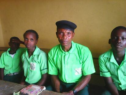 60-year-old Adalabu Seribor in uniform