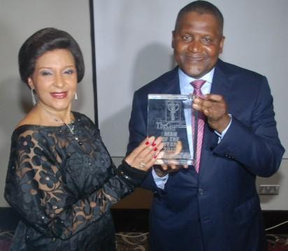 Left Lady Maiden Ibru, Publisher, Guardian Newspaper presenting the Guardian Man of the year award 2015 to Alhaji Aliko Dangote during the Guardian Man of the year 2015 award  ceremony held at Wheatbaker Hotel, Ikoyi, Lagos on Friday. Photo Lamidi Bamidele