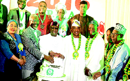 •Chairman, Omole Phase 1 Residents Association, Arc. Biodun Rufai(2nd left -front row), joins hands with some of the dignitaries to cut the anniversary cake during the 2016 O.P.R.A. Dinner and Awards  Night,