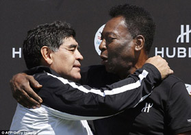 Together as one — Maradona and Pele embrace Thursday, ending a long standing feud