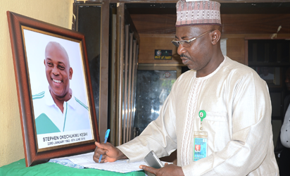 Secretary General of Nigeria Football Federation (NFF) Mohammed Sanusi signs the  book of condolences in tribute to late Stephen Keshi at the headquaters of the federation in Abuja, on June 8, 2016.