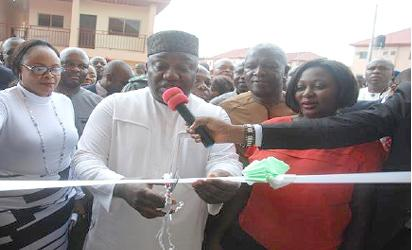 •Governor Ifeanyi Ugwuanyi (left) handing the keys to one of the lucky winners of the housing unit, Mrs.Ebere Oshi, while the state Commissioner for Housing, Engr. Ogbo Asogwa (2nd right), and the MD of COPEN Group,  the developers of the estate, Rev. Ugochi Chime, (2nd left), look on.