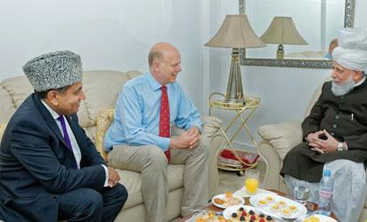 From left: Lord Tariq Ahmad of Wimbledon; United Kingdom Secretary of State for Transport, Chris Grayling and His Holiness, Hazrat Mirza Masroor Ahmad when Hon Grayling  paid His Holiness  a courtesy visit at the Baitul Futuh Mosque, South-West London.