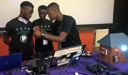 From left to right: Victor Shoaga, Blessing Oyatope and Babatunde Otaru setting their project for presentation before panel of Microsoft judges at the ongoing 2016 Imagine Cup worldwide finals holding in Seattle, Washinton. Photo By Emeka Aginam
