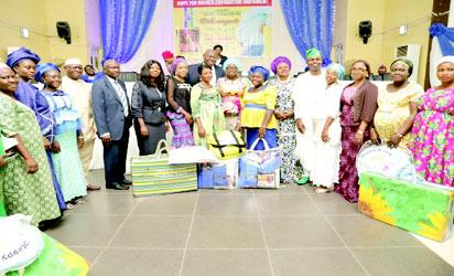 """Wife of the Governor of Lagos State, Mrs. Bolanle Ambode (m); Representative of Hope For Women in Nigeria Initiative, (HOFOWEM), Ms Oyefunke O. Adeleke (6th left); Mrs. Olayinka Oladujoye (6th right); LAHA Chairman, House Committee of Health, Hon Segun Olulade (5th right); Commissioner for Youth and Social Development, Mrs. Uzamat Akinbile-Yussuf (3rd right); SA. Primary Healthcare, Dr. Olufemi Onanuga (8th left); Commissioner for Health, Dr Jide Idris (2nd right); Honourable Commissioner for LG., Hon. Muslim Folami (4th left);  and beneficiaries, during the """"Hope for Expectant Mothers"""" support programme, organized by HOFOWEM, at Alausa."""