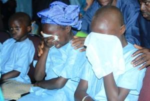 Late Deaconess Eunice Olawale's children in tears of agony during burial Service, on Saturday.