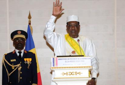 "Chad's president Idriss Deby (R) gestures during the inauguration of his fifth term as president on August 8, 2016 in N'Djamena.  Chad's President Idriss Deby took the oath of office August 8 for a fifth term in power, facing dogged resistance from an opposition that alleges his re-election was a ""political hold-up"". With tensions high a day after the death of a protester during an opposition march, around 14 African heads of state attended the swearing-in ceremony, including the presidents of Nigeria and Niger, both, like Chad, battling the Boko Haram jihadist group.  / AFP PHOTO /"