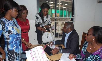 CANCER SCREENING: From right: Executive Director, Dr Omolala Salako and Project Director, Cervical Cancer Programme, Dr Kehinde Okunade both of Sebeccly Cancer Care and Support Centre, educating members of the Health Writers Association of Nigeria, HEWAN during a free cervical and breast cancers screening for women and girls in Lagos recently.