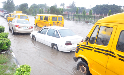 Flood at Ladipo Bus Stop along Lagos Abeokuta Express Road before Oshodi caused by  heavy down pour which started on Saturday and rained  till Sunday evening in Lagos. Photo; Joe Akintola