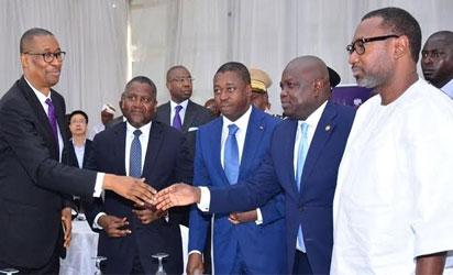 Lagos State Governor, Akinwunmi Ambode (2nd right), in a handshake with Minister of Trade, Investment & Industry, Mr. Okechukwu Enelamah (left) during the visit of the Togolese President to the Dangote Refinery at the Lekki Free Trade Zone, Lekki, Lagos, on Tuesday, August  2, 2016. With them are President of Togo, Mr. Faure Gnassingbe (middle); President, Dangote Group, Alhaji Aliko Dangote (2nd left) and Chairman, Zenon Petroleum & Gas Limited, Mr. Femi Otedola