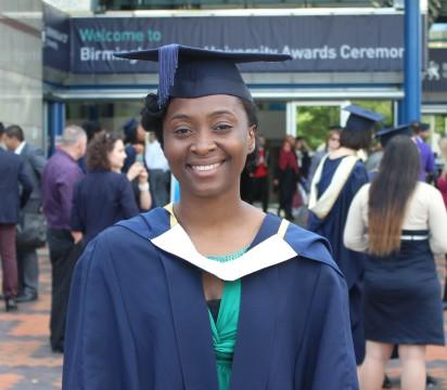 Graduation – Anu Yusuf in her cap and gown outside Symphony Hall, before receiving her LLB Law from Birmingham City University