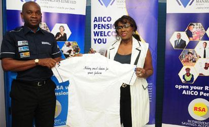Managing Director, AIICO Pension Managers Limited. Mr Eguarekhide Longe presenting a souvenir to Joke Silva