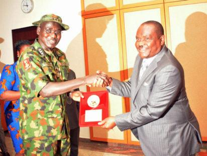 Rivers State Governor, Nyesom Ezenwo Wike receiving a plaque of appreciation from the Chief of Army Staff, Lieutenant General Tukur Buratai after the visit of General Buratai to Government House, Port Harcourt on Monday