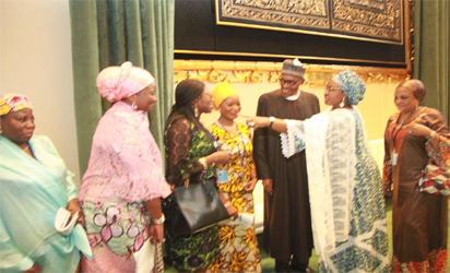 the First Lady, Hajia Aisha Buhari introducing members of her entourage to President Muhammadu Buhari after the President delivered his addressthe  71st UN General Assembly at the UN Headquarters, New York. Photo by Abayomi Adeshida 20/09/2016