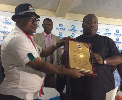 Chairman, NLC Lagos chapter, Comrade Tokunbo Korodo presenting award of Labour-friendly Company and Employer to the Chairman/Chief Executive Officer, Capital Oil & Gas Industries Ltd, Dr. Patrick Ifeanyi Ubah, in Lagos.
