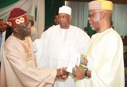 Member Organizing Committee, Mallam  Ismaila Isa (m) watched the APC National Leader, Asiwaju Bola Tinubu exchange pleasantries with the APC National Chairman, Chief Odigie Oyegun during the presentation of a book titled Muhammadu  Buhari: The Challenges Of Leadership In Nigeria authored by Prof. John Paden at the African Hall, International Conference Centre, Abuja. Photo by Abayomi ADESHIDA 03/10/2016