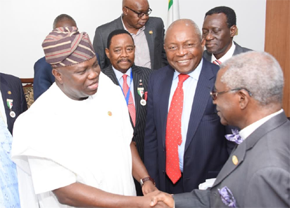 L-R: Lagos State Governor, Mr. Akinwunmi Ambode, with Patron, Nigerian-British Chamber of Commerce, Chief Micheal Olawale-Cole; immediate Past President, Prince Yemi Adefulu; Asiwaju Fola Osibo during a courtesy visit to the Governor, at the Lagos House, Ikeja, on Tuesday.
