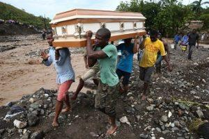 Hurricane Matthew: Haiti people carrying a dead person for burial. New York Times Photo