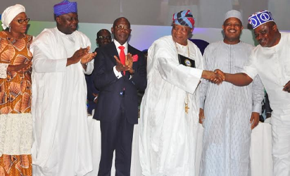 Lagos State Governor, Mr. Akinwunmi Ambode (3rd left); his wife & Chairman, Committee of Wives of Lagos State Officials (COWLSO), Bolanle (2nd left); Deputy Governor of Lagos State, Dr. Mrs. Oluranti Adebule (left); Edo State Governor, Comrade Adams Oshiomhole (middle); Sir Adebukunola Adebutu Kessington (3rd right) with the Certificate of Appreciation by COWLSO;  Kebbi State Governor, Alhaji Atiku Bagudu and Speaker, Lagos State House of Assembly, Rt. Hon. Mudashiru Obasa during the closing ceremony of the 16th Annual National Women  Conference organized by COWLSO, at the Convention Centre, Eko Hotel & Suites on Wednesday.