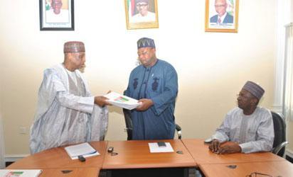Senator Magoro, left,  presents the report to the Vice chairman, North West, Inuwa Abdul-Kadir