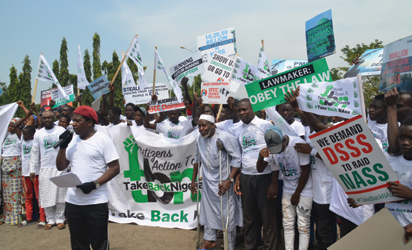 Citizens Action protesting at the gate of National Assembly Abuja to Take Back Nigeria. Photo by Gbemiga Olamikan.